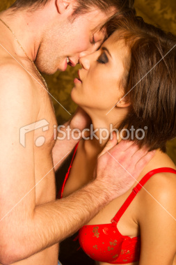 stock-photo-18981077-sensual-young-couple-kissing